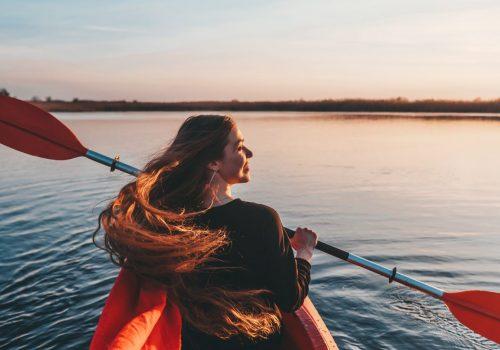 woman-holding-paddle-kayak-river